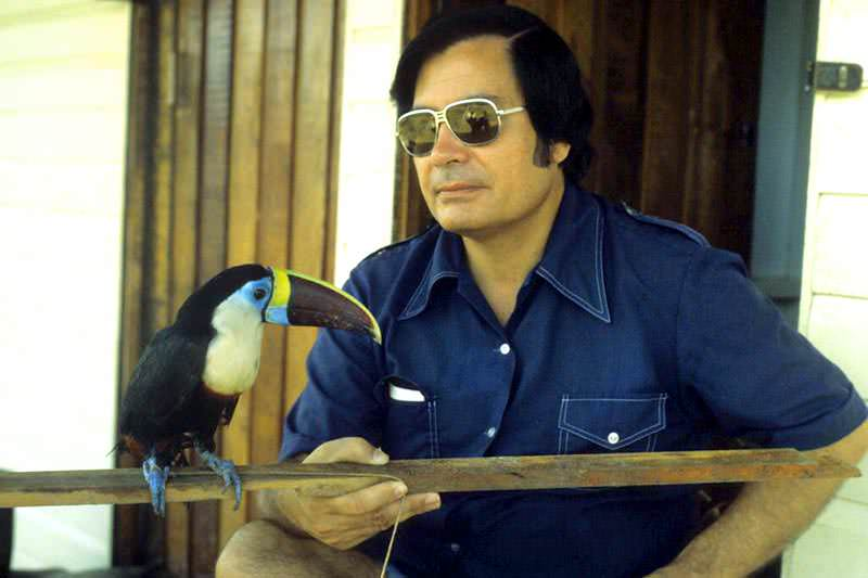 Jim Jones with a toucan in Jonestown