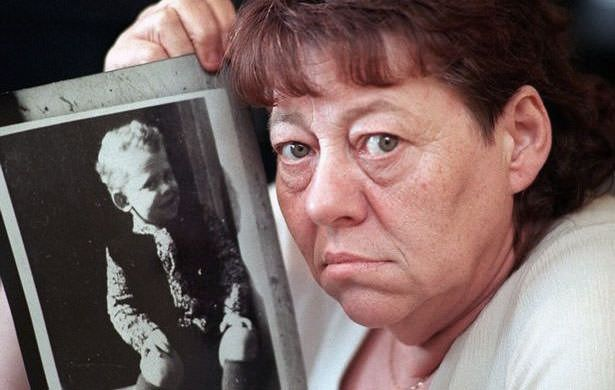 June Richardson holding a photograph of her son Martin Brown