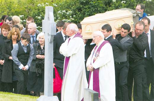 Niall Stapleton (in grey waistcoat) carrying his mum's coffin