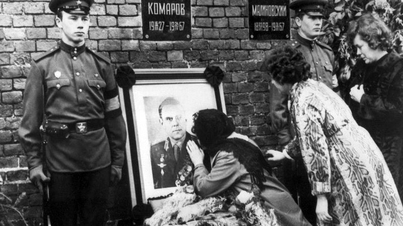 Widow Valentina Komarov kissing the photo a photograph of her dead husband during his official funeral Moscow's Red Square.