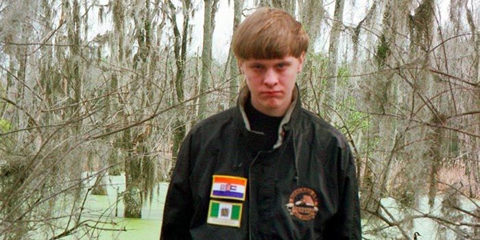 Dylann Roof with an apartheid jacket