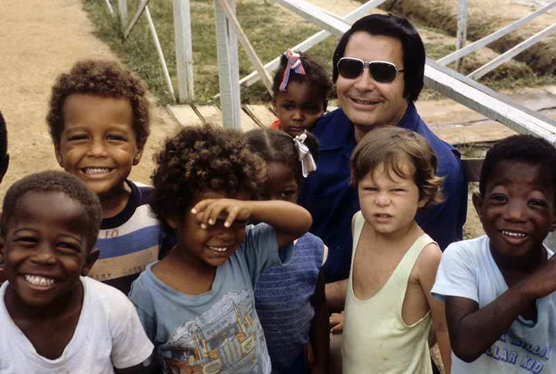 Jim Jones in Jonestown with children