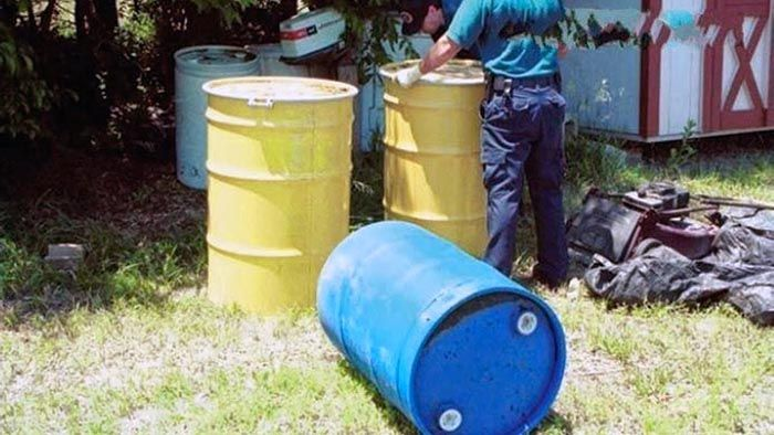 55-gallon metal barrels belongig to Robinson