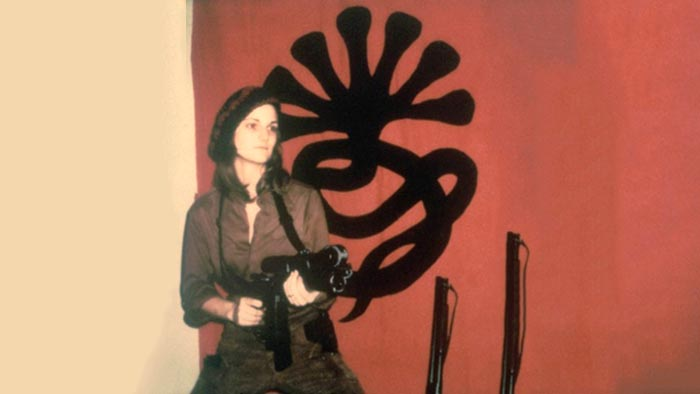 Patty Hearst posing with a gun