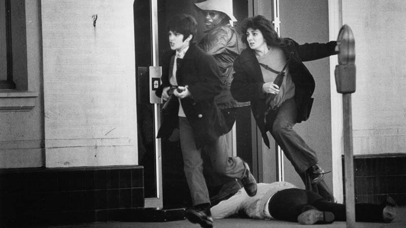 Patty Hearst and Nancy Ling Perry flee the Hibernia Bank, 15 April 1974.