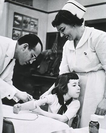 Jonas Salk gives the polio vaccine