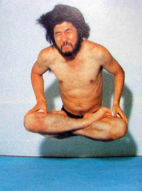 Shoko Asahara floating in air