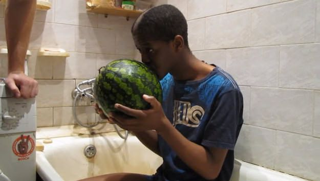 Black student forced to kiss a watermelon